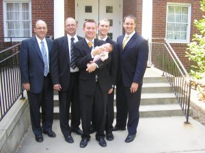 Fiona with those who participated in her naming and blessing (left to right): our bishop; Dustin's stepfather; Dustin; one of Dustin's mission companions; and one of Dustin's friends.