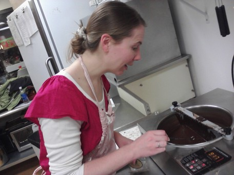 Susan poses with the tempering machine following the class.