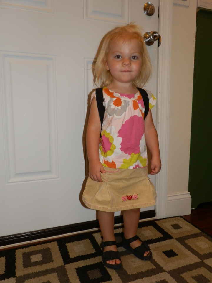With her backpack on, Fiona is ready to head out the door for her first day at school.