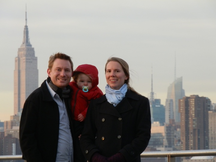 This photo accompanied our letter, both in the mail and on Facebook. We were standing on the pier—which, as you can see, offers a great view of the Midtown Manhattan skyline—at the end of North 5th Street in Williamsburg, Brooklyn. Over Dustin's right shoulder is the Empire State Building, and the spires over Susan's left shoulder are, left to right, 4 Times Square (also known as the Condé Nast Building) and the Bank of America Tower at 1 Bryant Park.