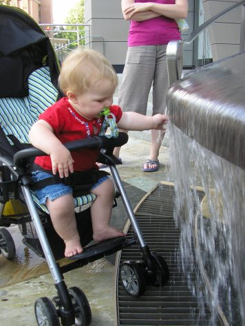 Fiona insisted that she be allowed to play with the water in this fountain in downtown Silver Spring, Maryland (just outside Washington, D.C.).
