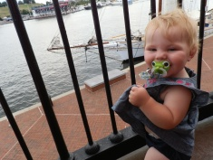 Fiona looks out over Baltimore's Inner Harbor from the walkway of the Seven Foot Knoll Lighthouse.