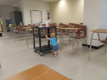 Fiona pushes a cart in a classroom at Bladensburg High School in Prince George's County, Maryland, where Susan taught at the time.