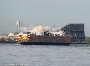 The Staten Island Ferry Dustin was on as he was recording this video. Building 877 on Governors Island is seen imploding behind the ferry.