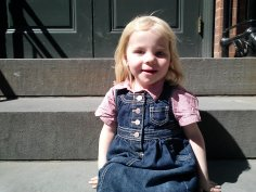 Fiona waits for the bus on a stoop at 85 Water Street, Brooklyn.