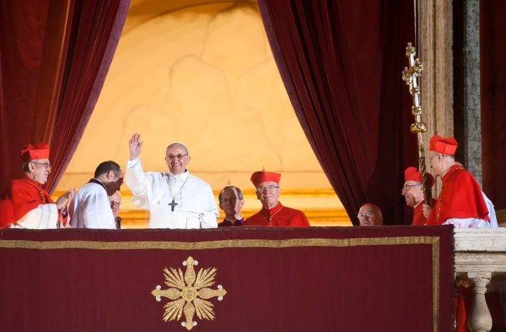 Francis appears on the balcony of Saint Peter's Basilica for the first time as pope.