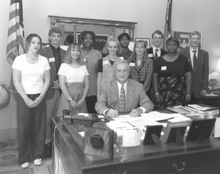 "Dustin (far right, in case you can't tell) with the other pages who served that week with then-governor James B. Hunt in his office in the North Carolina State Capitol. The governor took a moment to speak with the pages during our brief meeting with him. I mentioned that that year a teacher of mine discovered in class that a student had brought a knife to school, but the teacher didn't do anything about it. He basically said, ""That's bad,"" and moved on. Which is a demonstration of both the way government works and what students got away with in a pre-Columbine world."