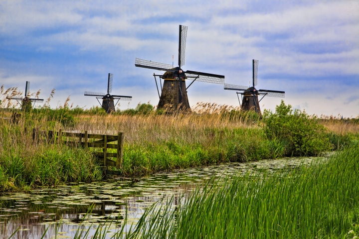 Windmills on the Kinderdijk in the western Netherlands. The 19 old windmills here are the largest concentration of historic windmills in the country and were declared a UNESCO World Heritage Site in 1997.