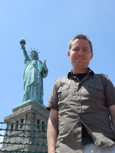 Finally there: Dustin stands on Liberty Island in front of the Statue of Liberty after visiting the statue's crown.