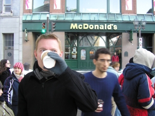 Dustin looking like the awesome American he is, drinking Starbucks hot chocolate in front of McDonald's in Québec City.