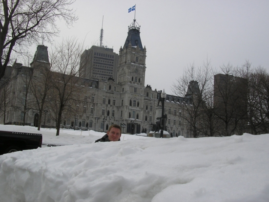 Dustin peeks his head over the snow piled high in front of the Hôtel du Parlement.