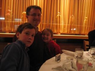 M.H.G., Bob, and C.H.G. at dinner