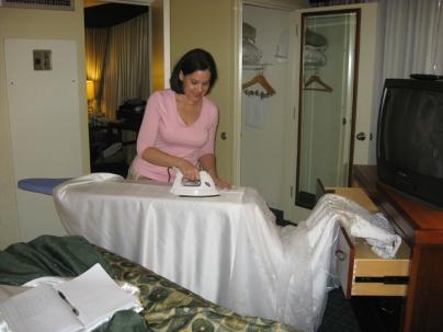 Rebecca irons Susan's dress.