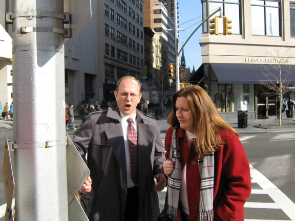 """It's cold!"" Randy exclaims, crossing Broadway with Tania."