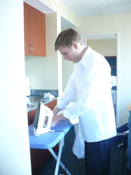 Matthew B. irons Dustin's shirt.