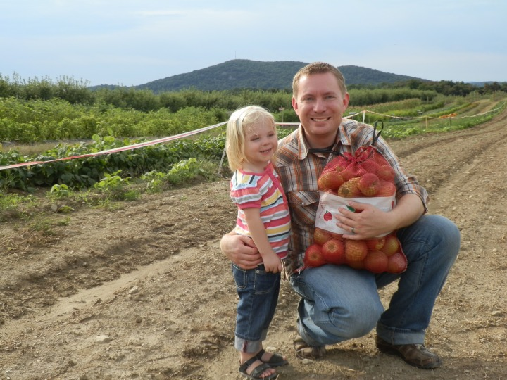 Fiona and Dustin with a bag of apples they handpicked at Fishkill Farms, Hopewell Junction, New York.