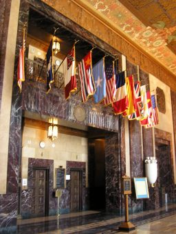 The flags that hang from the balcony above the elevators include those of the various nations that have ruled Louisiana throughout its history: Castile and Leon; France, with both the flag of Bourbon France and the modern French tricolor; Bourbon Spain; the United Kingdom; the Republic of West Florida; the Louisiana national flag; the third national flag of the Confederate States of America; Louisiana's modern state flag; and the United States of America, with both a 15-star flag and the modern flag.