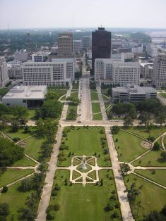View of the capitol grounds and downtown Baton Rouge from the observation deck. Notice the Mississippi River in the upper right.