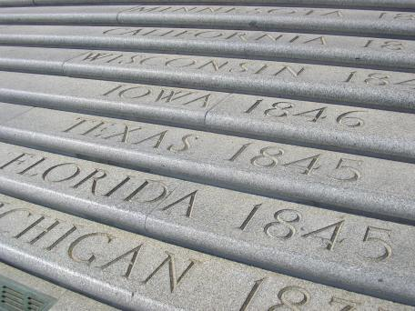 Forty-nine steps lead to the capitol's entrance. The names of the states are inscribed on the steps in the order in which they joined the Union. The top step is inscribed with E pluribus unum, flanked by Alaska and Hawai'i, which were admitted to the Union in 1959, more than two decades after the capitol was completed.