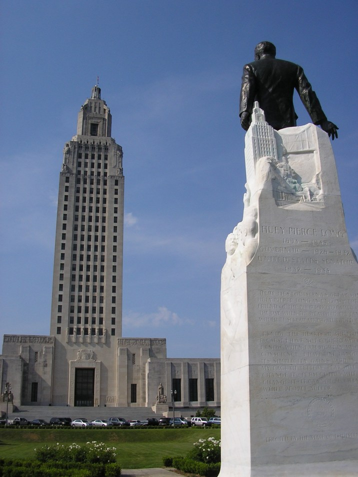 Huey Long, who was governor of Louisiana from 1928 to 1932 and championed the construction of the capitol, is buried in the center of the grounds in front of the building. This monument marks his grave.