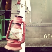 A lantern hangs from a post outside the railway post office car.