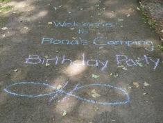 A greeting in sidewalk chalk.