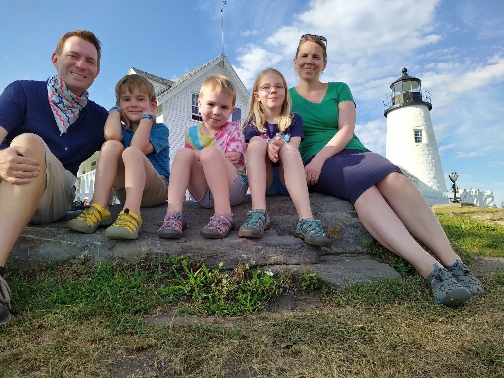 (Left to right) Dustin, Colin, Heath, Fiona, and Susan sit in front of the Pemaquid Point Light, a lighthouse in Maine, on 13 August 2020.